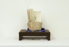 Patricia Fernandez. third arrangement. 2013. carved walnut, paper, clay and watercolor. 10 x 17 x 7 inches